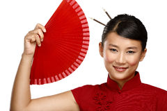Traditional asian woman holding a red beautiful fan Royalty Free Stock Photo