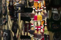 Traditional Asian women`s jewelry with embroidered colored thread and silver coins. In a street market store royalty free stock images