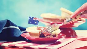 Traditional Australian Meat Pies for Australia Day celebration, vintage wash. Traditional Australian Meat Pies for Australia or Anzac Day holiday party food, in stock photo