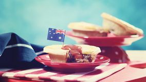 Traditional Australian Meat Pies for Australia Day celebration, vintage wash. Traditional Australian Meat Pies for Australia or Anzac Day holiday party food, in royalty free stock photos