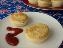 Traditional Australian Meat Pies And Tomato Sauce. Stock Photos