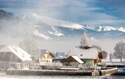 Traditional Austrian town in mountains covered by snow Stock Photography