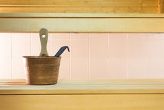 Traditional and authentic Finnish city sauna. Wooden bench and tiles in the wall in Finland. Stock Images