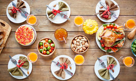 Traditional autumn meal. Rustic meal with vegetables, roasted chicken, homemade dessert on a nicely settled table royalty free stock image