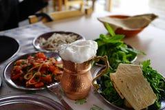 Traditional ayran. Specific meal in Aksaray neighbourhood in Istanbul. salads, ayran, pide, organs skewers, kebaps Stock Photo