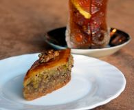 Traditional Azerbaijani baklava and tea. Traditional Azerbaijani baklava on a plate and tea with lemon Stock Image