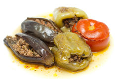 Traditional Azeri baked, stuffed peppers, aubergin. ''Badimjan Dolma''. Traditional Azeri baked, stuffed peppers, aubergine and tomatoes Royalty Free Stock Photography