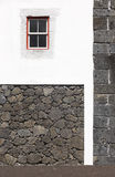 Traditional Azores building facade with volcanic rocks and white Stock Photo