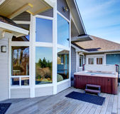 Traditional back deck with tall windows, and jacuzzi tub. Stock Photos