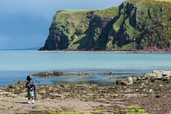 Traditional bagpiper in full dress code near Pennan. Traditional bagpiper in the scottish highlands near Pennan royalty free stock photos
