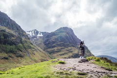 Traditional bagpiper in the scottish highlands Royalty Free Stock Image