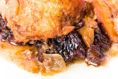 Traditional baked pork with dried plums. Royalty Free Stock Photos