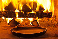 Traditional baking bread. In an old stone oven Royalty Free Stock Image