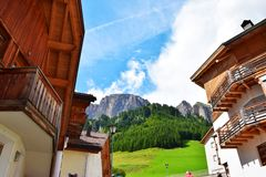 Traditional balconies and Dolomiti mountains Stock Images