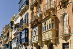 Traditional balconies in Valletta Malta. Valletta Malta downtown houses with colorful balconies and doors, facade view Royalty Free Stock Image