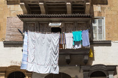 Traditional balcony with laundry, island Malta. Typical traditional balcony in the capital of Malta - Valletta. Clean laundry getting dry in the sun Stock Photography