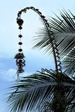 Traditional Bali Penjor. Bamboo pole with decoration on village street. Royalty Free Stock Images
