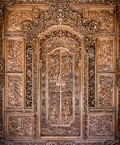 Traditional balinese craftsmanship. Wooden handmade decorated door royalty free stock photography