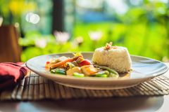 Traditional Balinese cuisine. Vegetable and tofu stir-fry with rice royalty free stock image