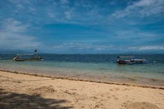 Traditional balinese dragonfly boat on the beach. Jukung fishing boats on Sanur beach, Bali, Indonesia, Asia Royalty Free Stock Photos