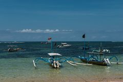 Traditional balinese dragonfly boat on the beach. Jukung fishing boats on Sanur beach, Bali, Indonesia, Asia Royalty Free Stock Photo