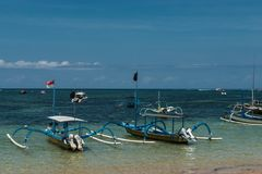 Traditional balinese dragonfly boat on the beach. Jukung fishing boats on Sanur beach, Bali, Indonesia, Asia Stock Images