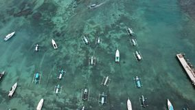 Traditional Balinese Fisher Boats at Sanur Beach, Bali, Indonesia. Drone`s view - Image stock images