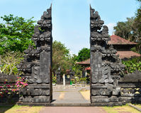 Traditional Balinese gate Candi Bentar in the temple Stock Photos