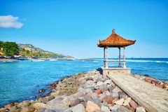 Traditional Balinese gazebo with ocean view Royalty Free Stock Images