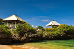 Traditional balinese hinduist temple on seashore. Traditional balinese hinduist temple on the rock at the seashore near Nusa Dua, Bali, Indonesia Stock Photo