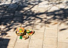 Traditional Balinese offering in the street stock image