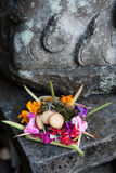 Traditional balinese offering to gods with flowers. In Bali, Indonesia Stock Photos
