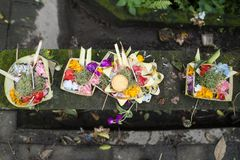 Traditional balinese offerings in a basket in Ubud, Bali, Indonesia. Traditional hindu balinese offerings as flowers and food in a basket in Ubud, Bali stock image