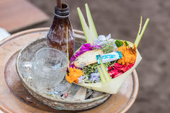 Traditional balinese offerings to gods in Bali with flowers and aromatic sticks. Tropical island Bali, Indonesia. Royalty Free Stock Photography