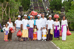 Traditional Balinese pilgrims. BALI - JANUARY 22. Balinese pilgrim family at Mother Temple in Besakih on January 22, 2012 in Bali, Indonesia. Most Balinese Royalty Free Stock Photography