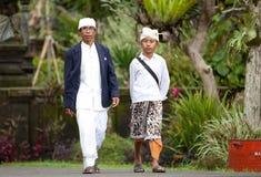 Traditional Balinese pilgrims. BALI - JANUARY 22. Balinese pilgrims at Mother Temple in Besakih on January 22, 2012 in Bali, Indonesia. Most Balinese hindus make Stock Photo