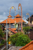 Traditional balinese roofs and ceremonial bamboo decorations, Ubud Stock Image