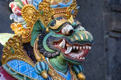 Traditional Balinese statue of Barong on a street temple in Bali, Indonesia Royalty Free Stock Photo
