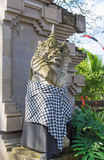 Traditional Balinese statue of the security guard at city gate Royalty Free Stock Photo