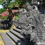 Traditional Balinese stone dragon image in the temple Royalty Free Stock Image