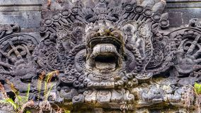 Traditional Balinese stone sculpture art and culture at Bali, Indonesia stock images