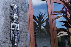 Traditional balinese stone statue on stone background. Tropical villa on Bali island, Indonesia. Stock Images