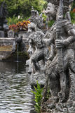 Traditional Balinese Warrior's Sculptures in sacred garden. Stock Photos