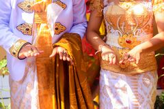 Traditional Balinese wedding, ritual with coins, Bali, Indonesia stock photography