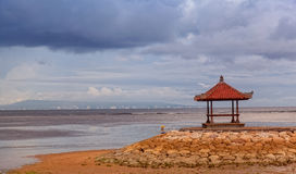 Traditional baliysky arbor. On the bank of the Indian Ocean in cloudy weather Royalty Free Stock Photo