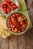 Traditional Balkan food: pasulj bean soup with sausage close-up stock images