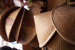 A traditional bamboo hat hanging on top Stock Image