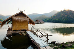 Traditional bamboo raft houses on the lagoon  with mountain background at khao wong reservoir Suphanburi province Thailand. Traditional bamboo raft houses on the Stock Photos