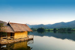 Traditional bamboo raft houses on the lagoon  with mountain background at khao wong reservoir Suphanburi province Thailand. Traditional bamboo raft houses on the Stock Photography