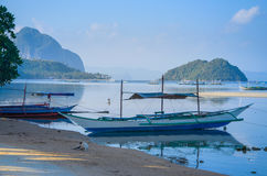 Traditional banca boat at sandy Corong Beach in El Nido, Philippines Royalty Free Stock Image